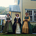 Three ladies from Seanchai Storytellers in accurate court garb.